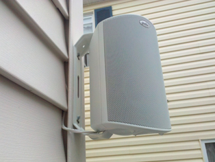 how to run speaker wire through wall to outside